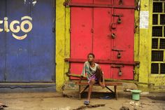 A boy sits on the streets in the capital of Freetown, Sierra Leone. Crown Colony, My Goals, Sierra Leone, African, Peace, History, Photos, Pictures, Photographs