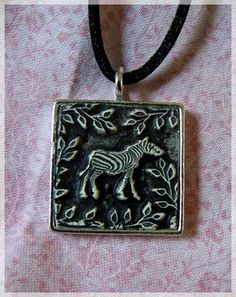 Clay Pendant tute  http://rstapestry.typepad.com/rubber_stamp_tapestry/stamping-with-polymer-clay/