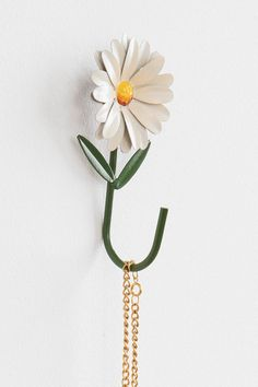 A little pricey for one hook... ($10) but really cute! Daisy Hook - Urban Outfitters