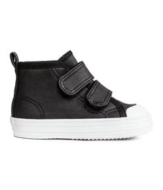 Black. High tops in imitation leather with rubber toe caps. Hook-loop fasteners at front and loop at back. Pile lining, cotton canvas insoles, and rubber