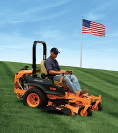 """Green grass, blue sky, """"Simply the Best"""" Scag mower and a beautiful flag.  Gotta love it."""