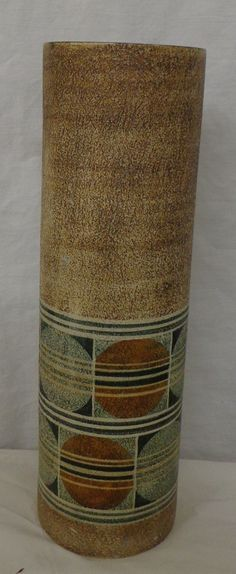 Lot 287 Troika Sleeve Vase Newlyn Factory Cornwall by Jane Fitzgerald circa brown textured finish with 2 bands of orbs approx. 14 H - 400 Brown Texture, St Ives, Vintage Ceramic, Artist At Work, Pottery Art, Cornwall, Jars, Arts And Crafts, Auction