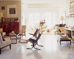 In the living area of a Manhattan loft designed by 2010 A-List designer Thomas O'Brien, circa-1970 Norwegian teak-and-canvas chairs from Neven + Neven Moderne; the floor was coated with layers of Benjamin Moore's industrial paint.