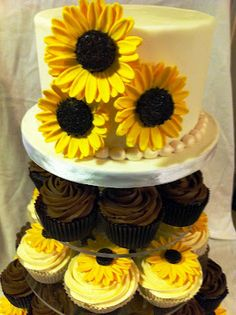 Sunflower wedding cake and cupcakes- I'm not sure if I like this, but I felt like I should pin it...