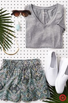 It's easy for the dog days of summer to get to you. Best way to beat the heat without sacrificing style? A pair of soft, flowy shorts paired with light-colored sneaks, a v-neck and simple accessories.