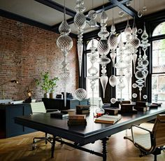now that is an office for inspiration...the brick, the black molding on the ceiling, that glass installation, those windows...divine...