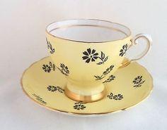Tuscan Teacup & Saucer Fine English Bone China Yellow Black Flowers