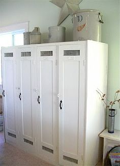 Wooden lockers painted white. Very cute.
