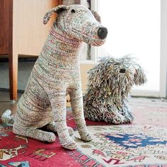 Recycled newspaper dogs.