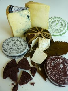 Three very different cheeses beautifully paired with stone ground and organic Taza Chocolalate Mexicano. This dairy-free dark chocolate has complex and tangy notes that complement each cheese in a spectacular way.-Belle Chevre Greek Kiss Goats Cheese with Cacao Puro Chocolate-Lancashire 1/2 lb. with Guajillo Chili Chocolate-Cashel Blue 1/2 lb. with Vanilla Bean ChocolateComes packaged in a handmade wooden box with straw. The pieces of cut cheese are double the size they were in last year's…