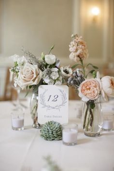 Anthropologie number cards — we used this for our wedding reception! And bud vases and tiny candles. Someone copied us. :)