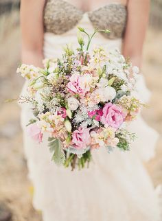 J'aime!! Stock, lisianthus, spray roses, ranunculus, Queen Anne's Lace, waxflower, dusty miller...fabulousness.