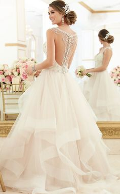 This Diamante beaded wedding dress from Stella York features lace and tulle, with a fitted sweetheart bodice and beaded shoulder straps that gather and fall into an intricate draped back design of sparkling jewels.