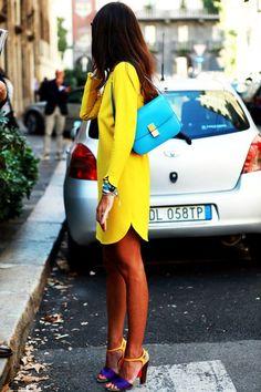 Bright yellow dress and a teal handbag.