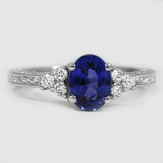 Platinum Sapphire Adorned Trio Diamond Ring // Set with a 8x6mm Blue Oval Sapphire #BrilliantEarth