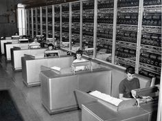 """Employees working at stations of a Multi-Position Letter Sorting Machine (from """"Systems at Work"""" exhibit)."""