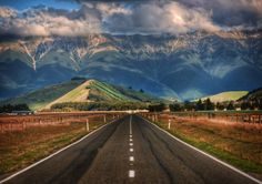 The Long Road to New Zealand. This is one of countless beautiful roads that crisscross New Zealand. Photo by Trey RatcliffR Beautiful Roads, Beautiful Places, Beautiful Scenery, Stunning View, Simply Beautiful, Wonderful Places, Beautiful Landscapes, Beautiful Sunset, Absolutely Gorgeous