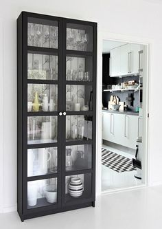 Decorate black cabinet with wallpaper