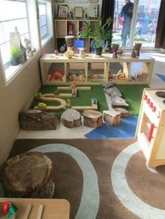 Natural emphasis childcare rooms - could be a fun rock area for building creating: