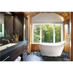 Soaking tub set in river rocks. Floor is wood-textured porcelain tile. Lovely…