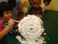 Farm Day! Children shear a sheep (blown up balloon covered with shaving cream) using popsicle sticks.