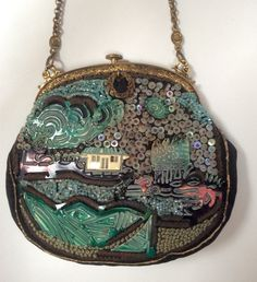 Early 20th century Oriental theme, and one of my favorite mixed media purses! Embroidered + colored carved celluloid accents + sequins + color lined glass beads ThePurseMuseum.com