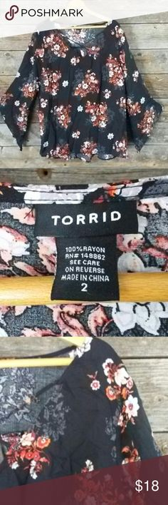 Torrid 2 (size 2X) angel long sleeve blouse Torrid 2 (size 2X) angel long sleeve blouse. Beautiful V-neck blouse with angel sleeves. Light material almost like a sheer (see through type of material). Great with jeans or dress pants or skirts.   Take a Look at My Lane Bryant Closet* *Many New and Great Price Lane Bryant Items* torrid Tops Blouses