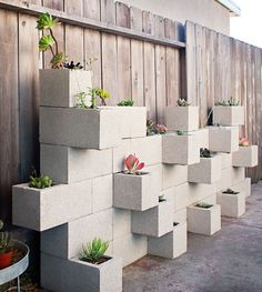 A planter wall made by stacking concrete blocks - it's like playing with LEGOs!