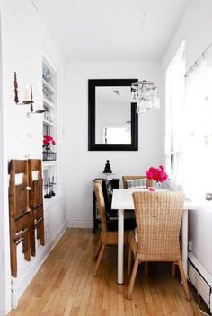 Often considered a design no-no in other rooms, placing furniture against the wall frees up space for walking in this narrow dining area. Folding chairs stored neatly on the opposite wall can easily be grabbed when company arrives. Click through for more genius ways to maximize small spaces (perfect for apartment style!).
