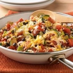 Zucchini, Black Bean and Rice Skillet  1-½ 	cups quartered lengthwise, sliced zucchini ½ 	cup diced green bell pepper 1 	can (15 oz each) Black Beans, drain, rinse 1 	can (14.5 oz each) Fire Roasted Diced Tomatoes with Garlic, undrained ¾ 	cup water 1 	cup instant rice, uncooked ½ 	cup shredded low fat Cheddar and Monterey Jack cheese blend
