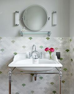 Victorian House, North London. This English china vanity basin with nickel stand is framed beautifully by handmade tiles in delicate green hues | Classic Design | Master Bathroom | China Vanity | Tiled Bathroom | Round Mirror | Luxury Bathroom | Bridge Taps | Bathroom Inspiration | Beautiful Bathroom