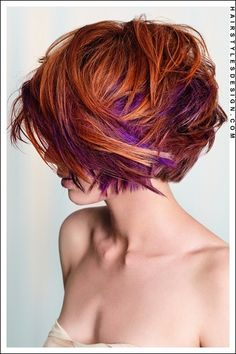 Beautiful short messy red bob hair cut with an eye catching hint of purple.