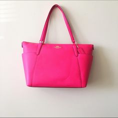 HPCoach Pink Tote NWT. Coach hot pink tote. Gold Coach emblem. In absolute perfect condition, never been used. Perfect color for spring & summer.  Reasonable offers welcome!  Bundle discount available!(20% off 3+ items)  No trades/off Posh transactions Coach Bags Totes