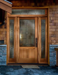 Front Door: Scarborough® 6316 with 6347 sidelights and 6745 transom | shown in Sapele Mahogany  Or Similar -