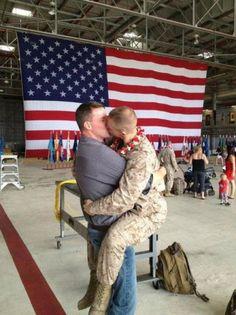A sort of homecoming - gay marine kisses his partner