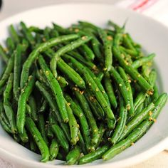 Fresh seasonal green beans need just basil leaves and minced garlic for great flavor. Photo credit: Amy Johnson from She Wears Many Hats.