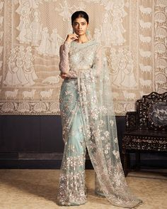 In delicate pastel hues our resham and cutdana embroidered saree with crystal embelishments and fringing permits an ease in movement. Pakistani Bridal, Pakistani Dresses, Indian Bridal, Indian Dresses, Indian Outfits, Indian Sarees, Bridal Lehenga, Indian Designer Outfits, Designer Dresses