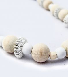 Beautiful Natural and White Asymmetrical Necklace consisting of different size natural and white beads separated by white wire pincushions. Sold @ www.wave2africa.com Wooden Necklace, Pincushions, White Beads, Online Gifts, Necklace Designs, Clay Jewelry, Fashion Accessories, Wire, Necklaces