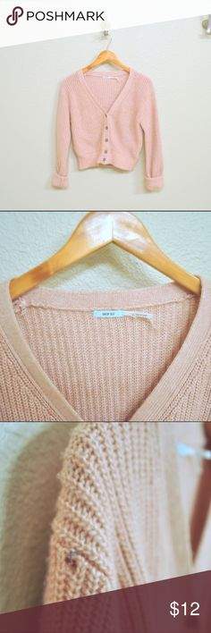 Urban Outfitters Pastel Cardigan Pastel pink crop cardigan by BDG (sold at Urban Outfitters). I've only worn this twice and I snagged the shoulder. The hole isn't very big though and is hardly noticeable when worn. Price reflects damage. Comfortable, thicker knit cardigan that would be perfect for layering this winter! Please no trades, try ons, or holds! BDG Sweaters Cardigans