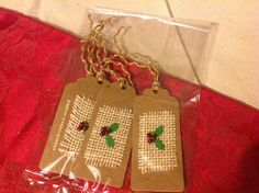 Holly leaf red bead berries on hessian tags with rope.
