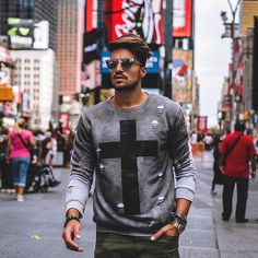 "Between the lights of Times Square @marianodivaio rocking the new ""X Sweatshirt"" by Nohow Black Collection • • • www.nohowstyle.com #Benohow #nohow"