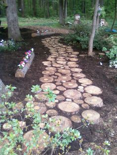 """Used a Pine tree for the walk. Cut thick """"slices"""". What was left over, is a flower log. Just cut the center out with a chainsaw."""