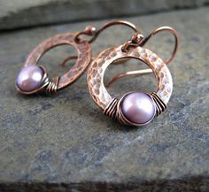 Hammered copper double cut discs with wire wrapping holding pearls...Folksy Shop