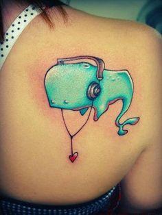 Cute sleeping whale tattoo