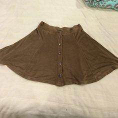 Tan, suede skirt from Tilly's! NWOT Brand new, never worn out, adorable suede skirt! I bought it for my trip and they had an XS (which this is) or a M.. I need a small! So cute! Tilly's Skirts