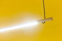 R16 pendant cardboard LED tube fixture illuminating the office of Valsplat in Amsterdam.