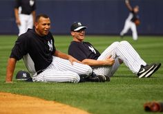Alex Rodriguez #13 and Lyle Overbay #55 of the New York Yankees share a laugh during warm-ups prior to the game against the Detroit Tigers at Yankee Stadium on August 9, 2013 in the Bronx borough of New York City. (Photo by Mike Stobe/Getty Images)