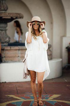 Erika Altes of whiskeyandlaceblog- Country Summer Festival with Teva   sunhat   shoes   fringe purse   sunglasses   necklace   Teva sandals