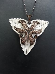 Beautiful pendant I found on Etsy. Can't wait to make more from this artist.  Tiwisted Triangle by Justyna Szlezak, Eridhan Creations. https://www.etsy.com/shop/EridhanCreations