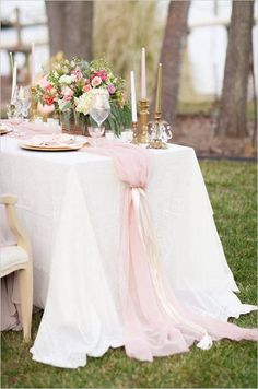 ~Romantic rustic elegant outdoor wedding tablescape with a large table with chiffon decorations, rose gold details and flower arrangements